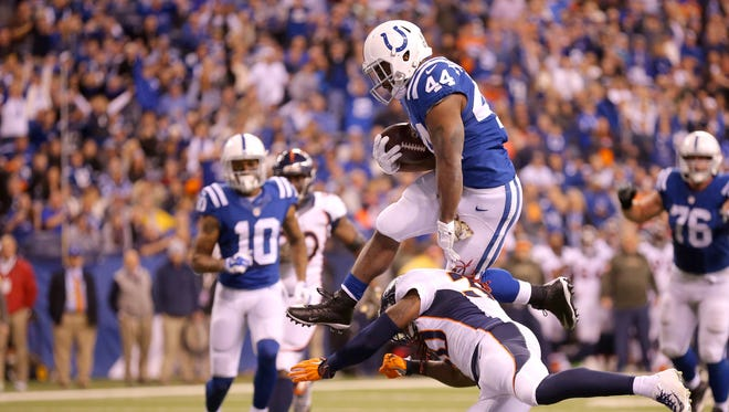 Indianapolis Colts running back Ahmad Bradshaw (44) leaps over Denver Broncos strong safety David Bruton (30) to score during the second half of an NFL football game Sunday, Nov. 8, 2015, at Lucas Oil Stadium.