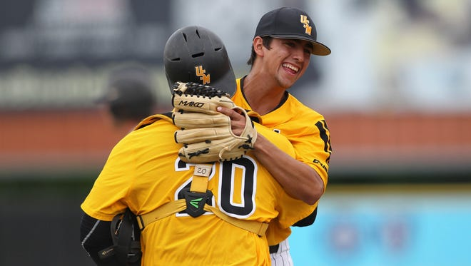 Southern Miss closer Nick Sandlin celebrates the final out of Saturday's win over Marshall with teammate Chuckie Robinson. The Golden Eagles advance to the Conference USA tournament championship game, which is set for 1 p.m. Sunday.