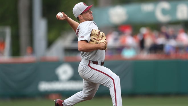 FSU's Drew Parrish pitches against Clemson during their game at Doug Kingsmore Stadium in Clemson, S.C. on Saturday, May 5, 2018.