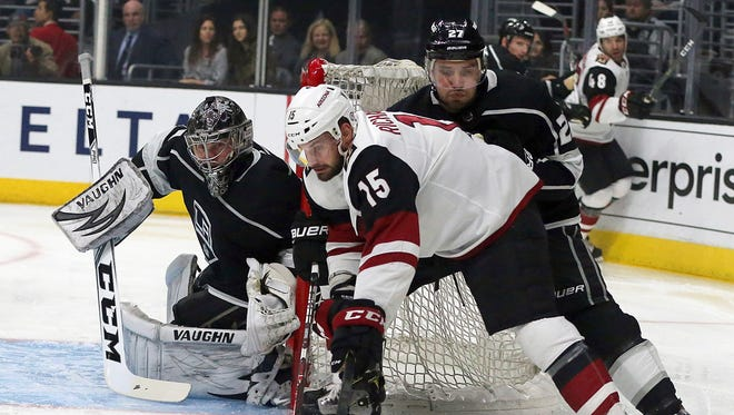 Arizona Coyotes center Brad Richardson (15) attacks as Los Angeles Kings goalie Jack Campbell (1) defends during the first period of an NHL hockey game in Los Angeles on Thursday, March 29, 2018. (AP Photo/Reed Saxon)