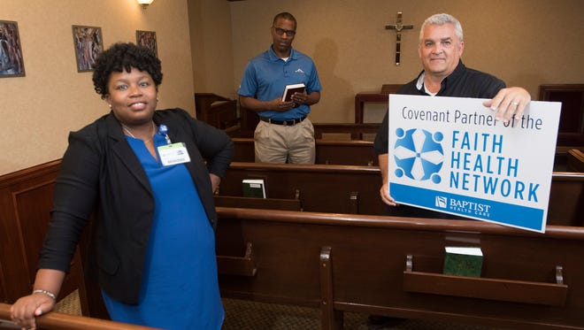 From left, Joy Sharp, Faith Health Network's program director, is working with church officials such as Lonnie Wesley, pastor of Greater Little Rock Baptist Church, and Rick Hazelip, pastor of First City Church, to help parishioners navigate the complexities of the health care system.