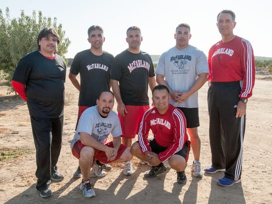 """Coach Jim White, far right, poses with the members of the 1987 McFarland High cross-country team that is featured in the Disney movie  """"McFarland, USA."""" (Photo: Disney Pictures)"""