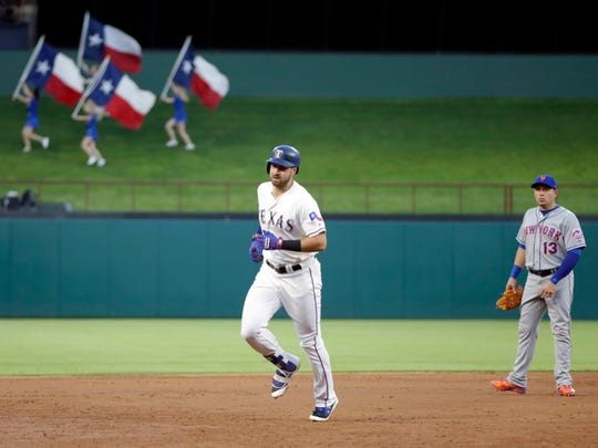 Texas Rangers first baseman Joey Gallo (13) rounds the bases after hitting a two run home run in the third inning against the New York Mets at Globe Life Park in Arlington on Tuesday, June 6, 2017.