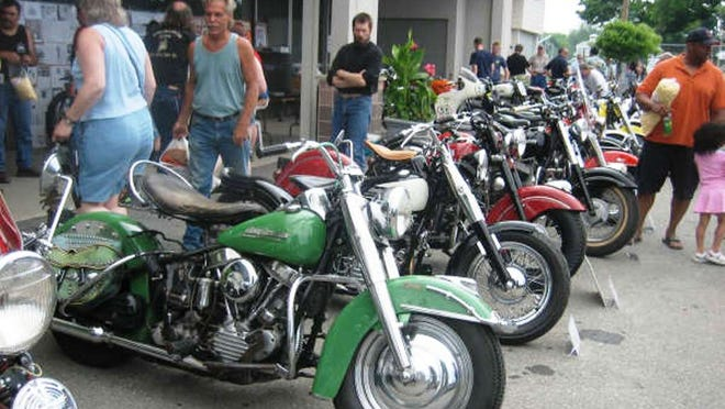 Attendees look over bikes on display at a previous Rhinebeck Grand National Meet. This year, the event continues today.