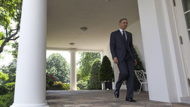 President Obama walks from the Oval Office to speak about Afghanistan on Tuesday.