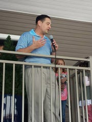 State senator and former Levinson Axelrod attorney Nicholas P. Scutari addresses the crowd at the grand reopening celebration of Levinson Axelrod's Belford office in September.