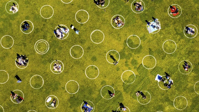 Circles designed to help prevent the spread of the coronavirus by encouraging social distancing line San Francisco's Dolores Park on May 21, 2020.