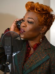 Local singer Monro Brown rehearses a song while working