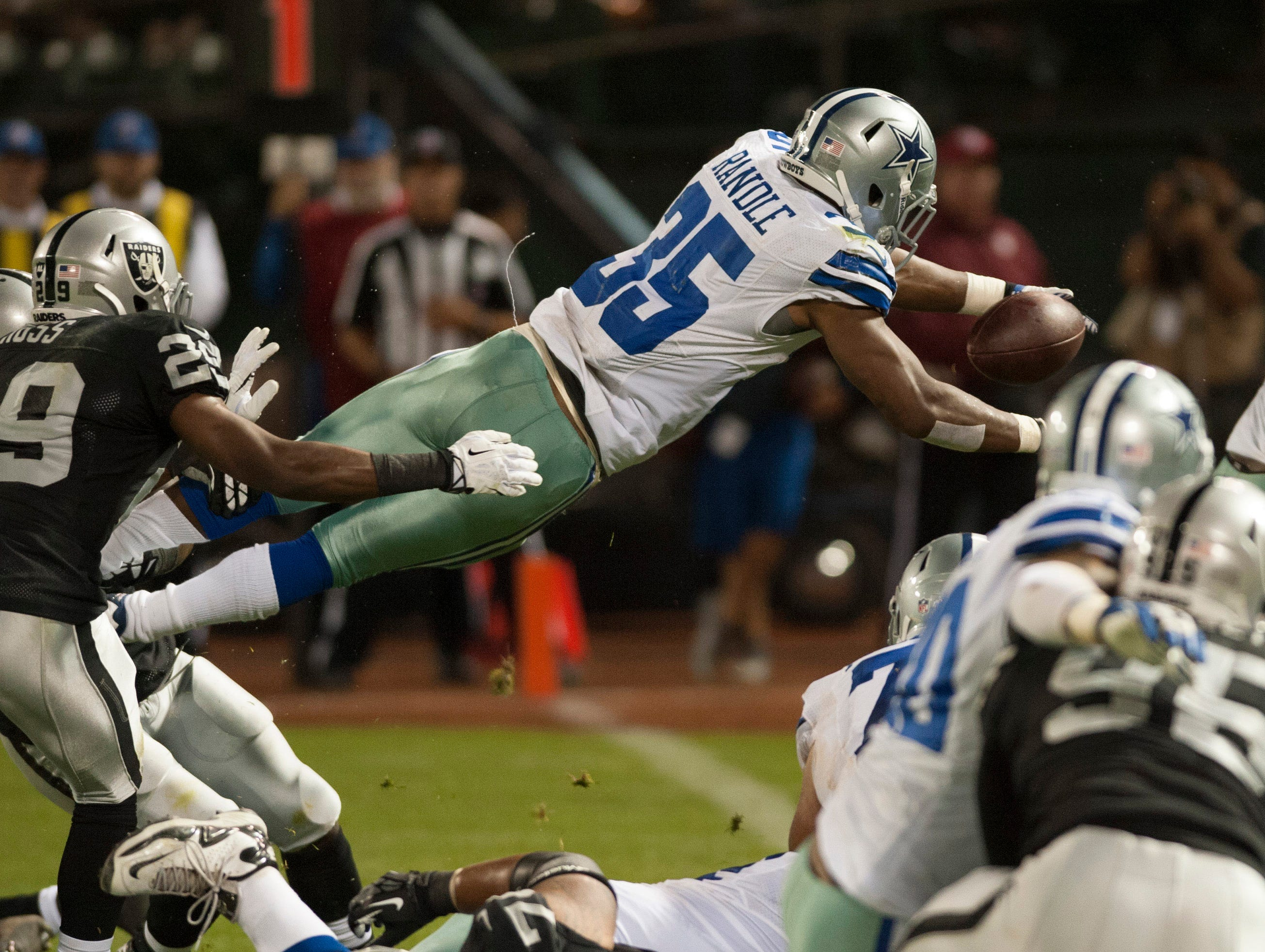 Dallas Cowboys running back Joseph Randle (35) dives for a touchdown during the fourth quarter at O.Co Coliseum.