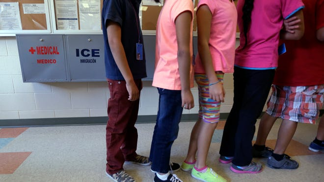 Detained immigrant children line up in the cafeteria at the Karnes County Residential Center, a temporary home for immigrant women and children detained at the border, in Karnes City, Texas. The Homeland Security Department has privately acknowledged that a remarkable number of young families caught crossing the border illegally earlier this year subsequently failed to meet with federal immigration agents, as they were instructed.