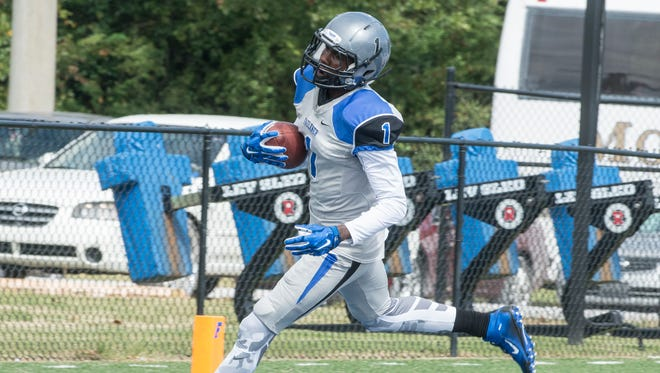 Faulkner wide receiver Rob Lockhart runs in for a touchdown. Faulkner University shut out Georgetown College at home on Saturday, Sept. 26, 2015, in Montgomery. Faulkner won 44-0.
