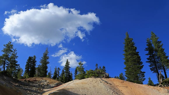 The Sulphur Works at Lassen Volcanic National Park add color to the mountainous landscape.