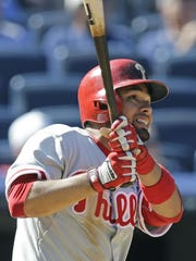 Philadelphia Phillies Andres Blanco hits a ninth-inning double in a baseball game against the New York Yankees at Yankee Stadium in New York, Wednesday, June 24, 2015. (AP Photo/Kathy Willens)