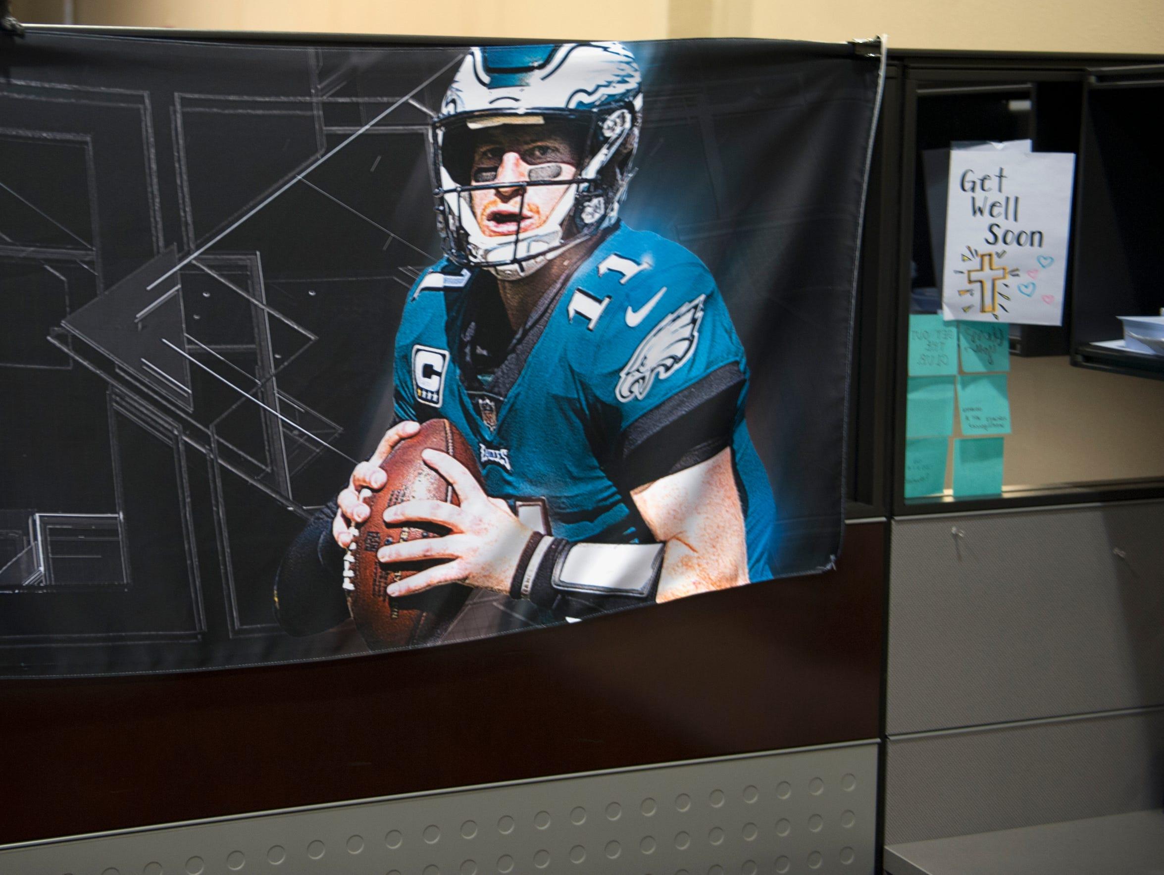 A photograph of Eagles quarterback Carson Wentz hangs