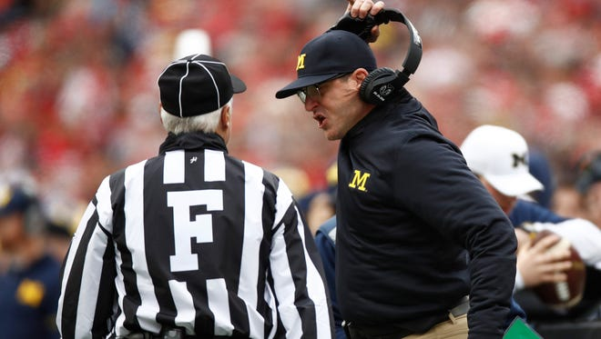 Michigan football coach Jim Harbaugh argues a call against the Ohio State Buckeyes on Nov. 26, 2016, in Columbus, Ohio.