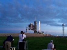 Photographers set up for Friday's SpaceX launch