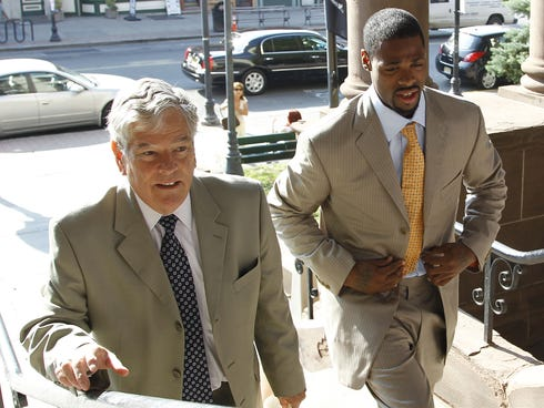 Tennessee Titans wide receiver Kenny Britt, right, walks with his lawyer John Hughes into Hoboken Municipal Court for a court proceeding, Tuesday, July 12, 2011, in Hoboken, N.J. Britt was charged June 8 with resisting arrest and related offenses aft