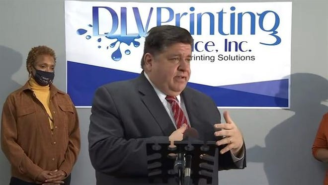 Gov. JB Pritzker promotes the state's Business Interruption Grant program while also urging Congress to pass a COVID-19 relief package that includes aid for state and local governments during a media event in Chicago.