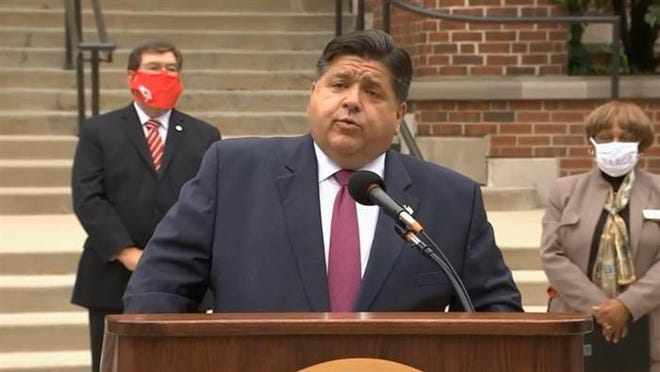 Gov. JB Pritzker takes questions from reporters Wednesday at a census-related news conference at Illinois State University in Normal.