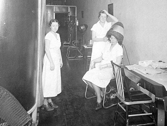 Chrystine Walton, left, working as a beautician, with