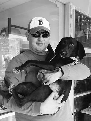 Philippe Muller, an engineer and project manager during the weekdays, doubles as an Uber and Lyft driver to raise funds for local animal rescue and shelter organizations. Here he's pictured with a dog Daisy that he fostered.