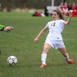 Plymouth Christian junior Jessica Paulson (No. 16) dribbles past Lutheran Northwest players during Thursday's varsity girls soccer contest.