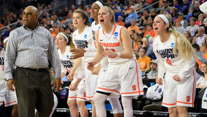 Irondequoit graduate Savannah Crocetti, right, cheers with other players on the Syracuse bench after one of the NCAA Tournament wins on the Orange's march to the NCAA championship game.