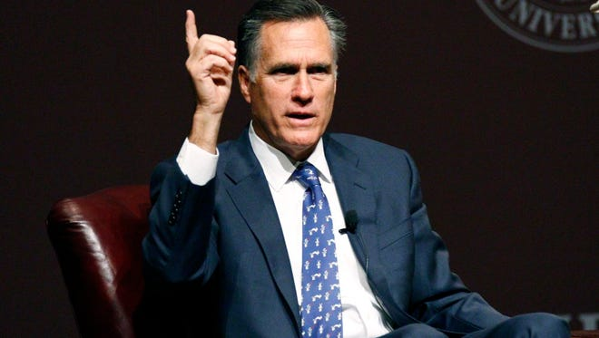 """Former GOP presidential candidate Mitt Romney answers questions during a question-and-answer period following his address to the student body and guests in Starkville, Miss., Wednesday, Jan. 28, 2015. Romney joked about his time as a candidate and addressed a number of world issues including terrorism, world economy and domestically """"the need for strong American leadership,"""" and job creation for Americans. (AP Photo/Rogelio V. Solis)"""