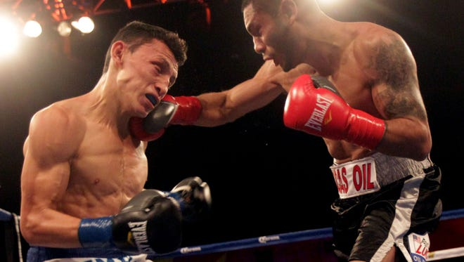 Andrew Cancio, right, lands a right to Rene Alvarado during their bout in 2015.