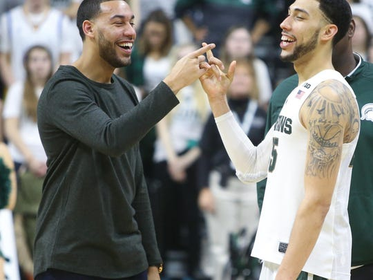 Drew Valentine congratulates brother Denzel Valentine after MSU beat Ohio State on March 5 at the Breslin Center. The senior star is now looking to win a national championship.