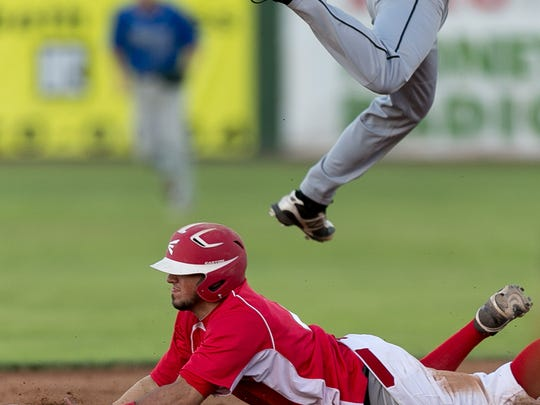 Infielder Trent Pell dives safely to second base in a 2014 ballgame. Pell was being sentenced Friday, July 26, 2019, to a sexual assault conviction.