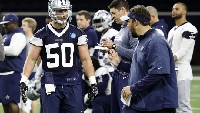 Dallas Cowboys outside linebacker Sean Lee (50) talks with former linebackers coach Ben Bloom, right, as he participates in drills at the team's training facility in Frisco, Texas, June 11, 2019. Bloom is now on the Cleveland Browns' coaching staff.