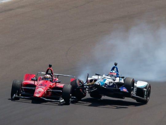 Takuma Sato  crashes into James Davison on the 47th lap Sunday.