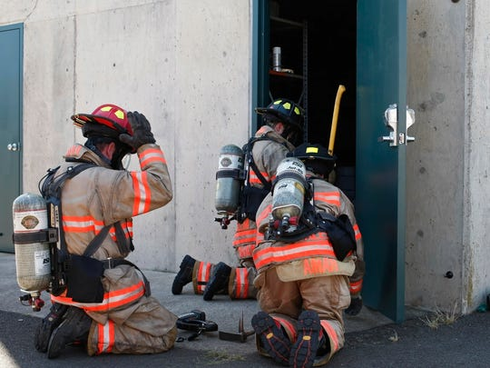 Newly hired fire fighters go through a training exercise at McNary Field on Wednesday.