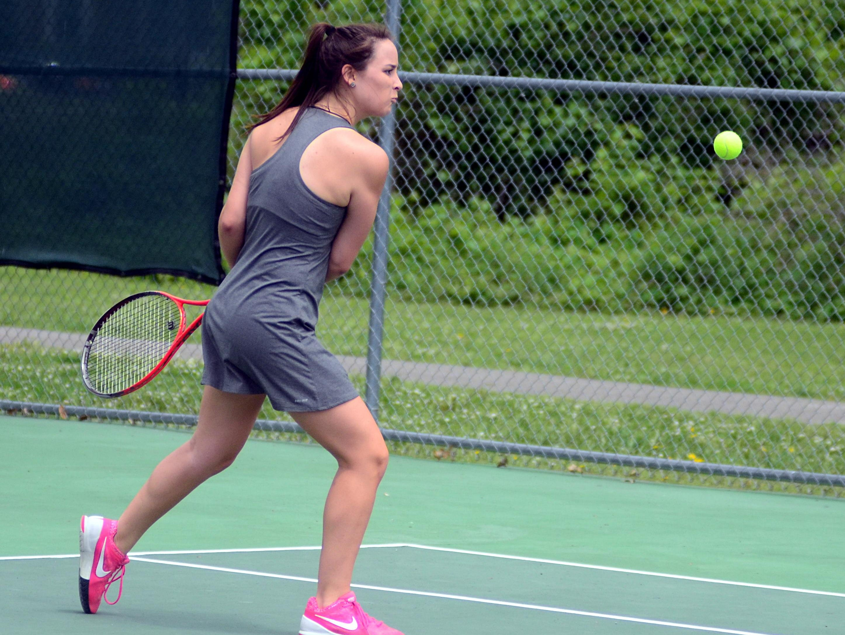 Hendersonville High sophomore Audrey Spurlock prepares to hit a backhand during Tuesday's District 9-AAA Individual Tennis Tournament. Spurlock suffered a three-set loss in the first round.