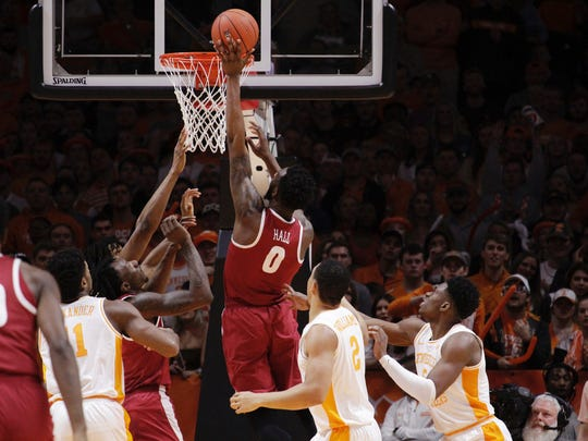 Alabama forward Donta Hall (0) tips the ball in against Tennessee in the first half of an NCAA college basketball game Saturday, Jan. 19, 2019, in Knoxville, Tenn. (AP Photo/Shawn Millsaps)