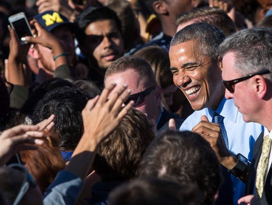 President Barack Obama greets attendees at a campaign event he and Chelsea Clinton spoke at on behalf of Hillary Clinton, at the University of Michigan in Ann Arbor, Mich.