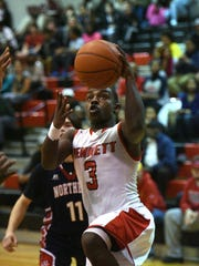 Bennett's Trayshawn Wright drives for a basket against