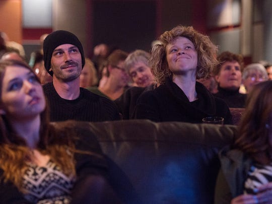 Jeff Abrams and Ra•ssa Huntley react to comments made by candidates during the final presidential debate shown at the Lyric Cinema Cafe in Fort Collins on Oct. 19.