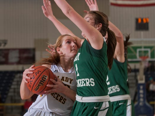 St John Vianney's Kellyt Campbell drives into New Providence's