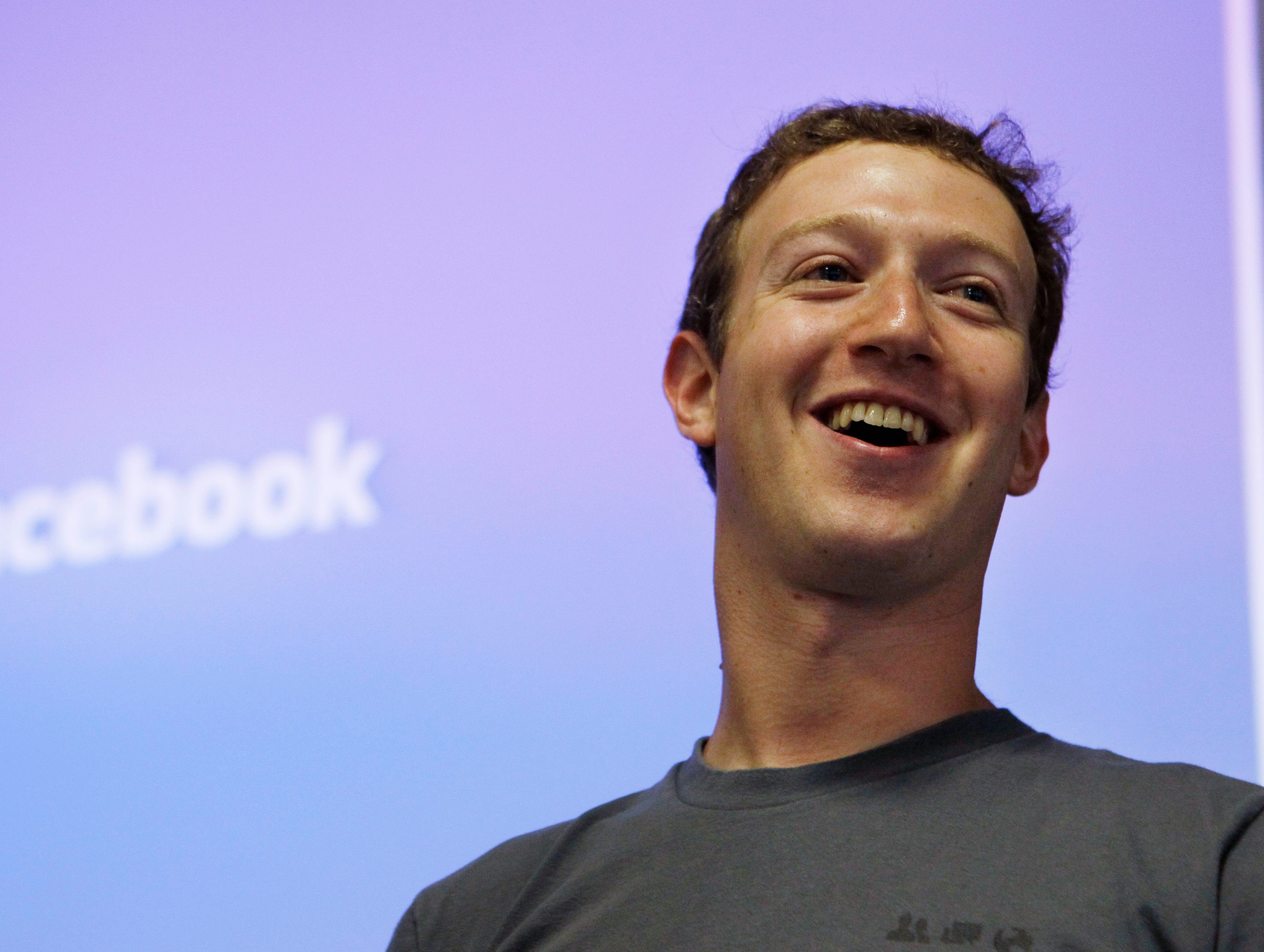 In this July 6, 2011 file photo, Facebook CEO Mark Zuckerberg smiles during an announcement at Facebook headquarters in Palo Alto, Calif.