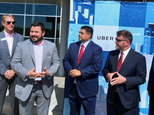 Chris Miller (second from left), of Uber announces Tuesday morning that the rideshare company is now open for business in Wichita Falls. Also pictured, from left to right, are David Farabe, board chairman of the Wichita Falls Chamber of Commerce & Industry; Wichita Falls Mayor Stephen Santellana; Wichita Falls Chamber of Commerce & Industry President and CEO Henry Florsheim; and Texas Sen. Craig Estes, R-Wichita Falls.