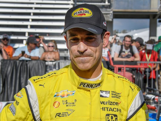 Team Penske IndyCar driver Helio Castroneves (3) looks