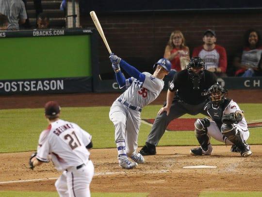 Dodgers rookie Cody Bellinger broke out of his postseason