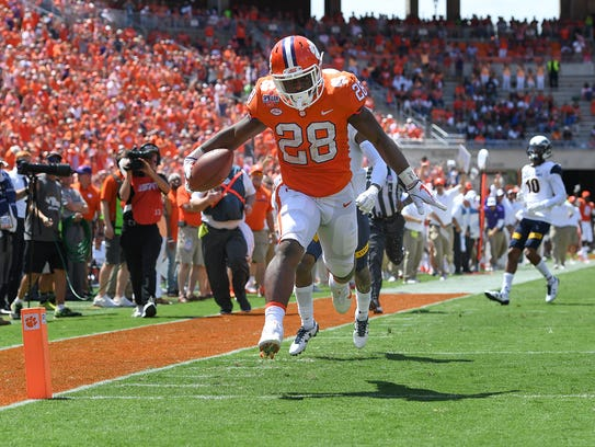 Clemson running back Tavien Feaster (28) scores against