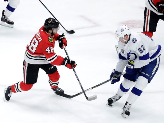 Tampa Bay Lightning's Andrej Sustr (62) blocks a shot by Chicago Blackhawks' Vinnie Hinostroza (48) with his skate during the second period of an NHL hockey game Monday, Jan. 22, 2018, in Chicago. (AP Photo/Charles Rex Arbogast)
