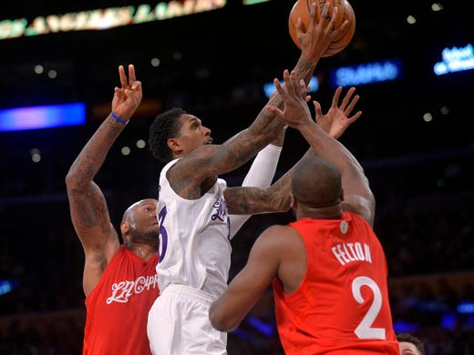 Lakers guard Lou Williams (23) moves to the basket 360ed30ae