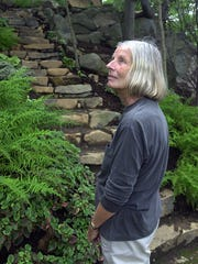 The late artist, author and landscape architect Judy Tomkins is shown in a garden she designed in Sneden's Landing in this 2001 photo.