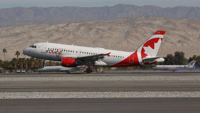 An Air Canada flight lands at the Palm Springs International Airport, December 14, 2016.