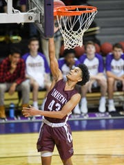 Ankeny's Jaxon Smith (43) goes up for a break away